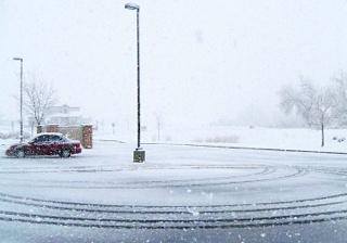 manage-snow-and-ice-to-preserve-asphalt-parking-lot.jpg